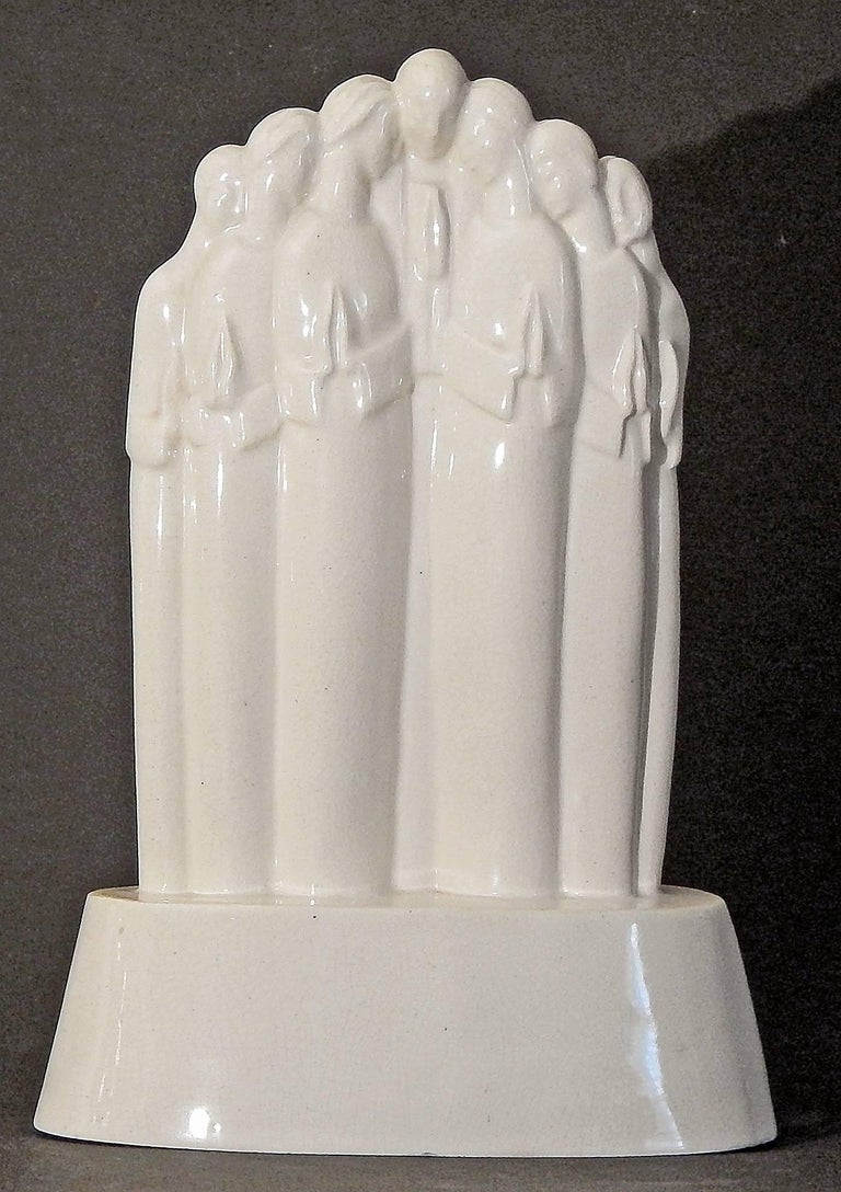 One of the rarest and most important sculptures eminating from the ARKO ceramic school established by Alexander Archipenko in Woodstock, New York, this stylized group of praying figures was created by Lu Duble. Archipenko studied in Kiev and Paris