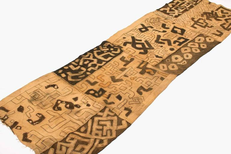 Handmade from rafia and hand-stitched with great artistry, this Kuba dance cloth is powerful as a graphic piece of art. It has some soiling consistent with its use. It would make a great wall hanging. The artistry of the design is powerful.  A great
