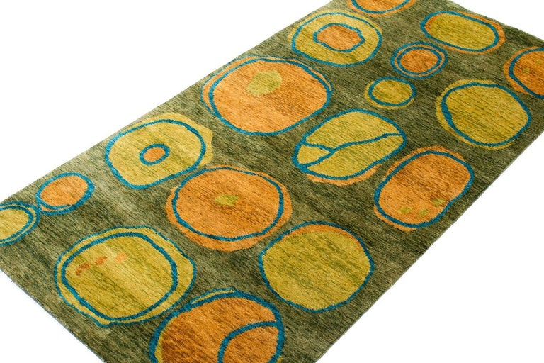 This grassy green carpet is an original design by Joseph Carini titled 'Otto'. Hand-knotted in Nepal in matka silk - matka silk is coarser than regular silk, it vaguely resembles linen, it is a simple and elegant material which is often used for