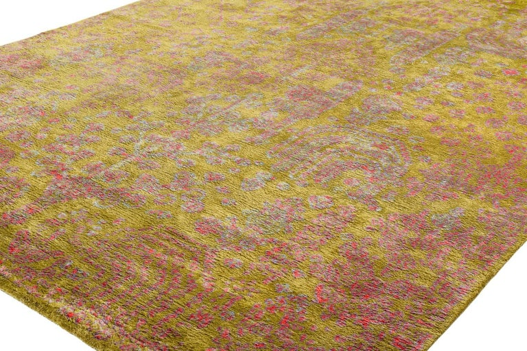 The 'Ankara' design is a glistening, delightful jewel within our collection. It's gorgeous, palette of violet, pink, chartreuse and baby blue gives it an uplifting palette. In 100% silk with a plush pile height, this rug is as soft as can be and