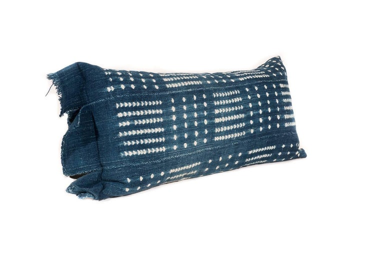 Made from Indigo tie-dyed African textiles and stuffed with a nice blend of down and goose feather. The textile has been backed and is beautifully crafted with a zipper for easy removal.