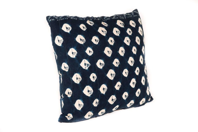 This large pillow is made from a vintage African textile. The polka-dot pattern is formed using complex tie-dye techniques with natural indigo. The best part is the soft and raw organic cotton which has backed for durability. The cushion content is