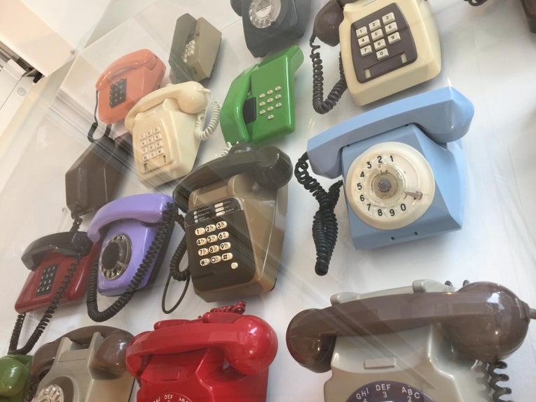 It's full title is 'Revised Nomenclature V: Five squared, Vintage Telephony', a captivating and colourful ensemble of telephones spanning 100 years. Many European and American from the 1970s, and including ones from the Soviet Union and from Latvia.