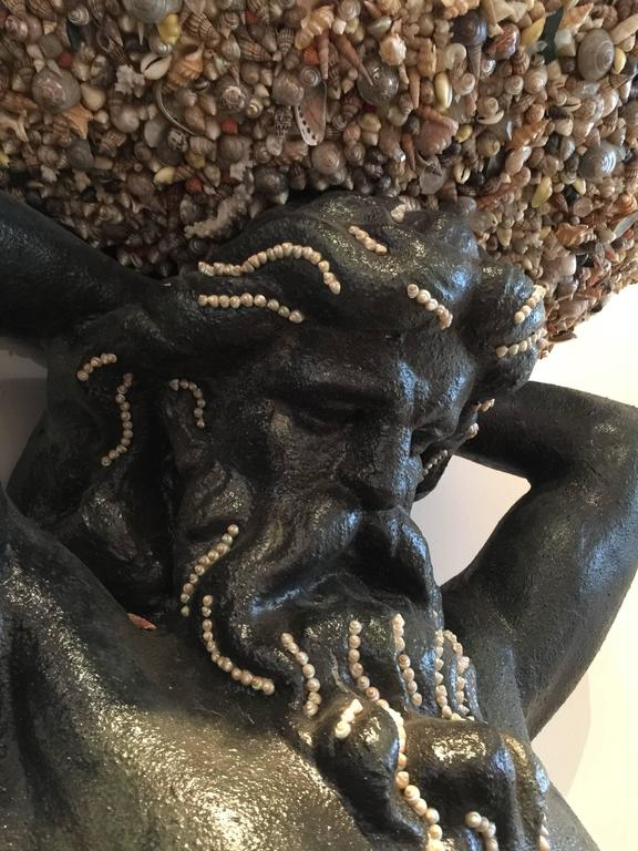 Spectacular painted resin sculpture of the sea god, encrusted with seashells.