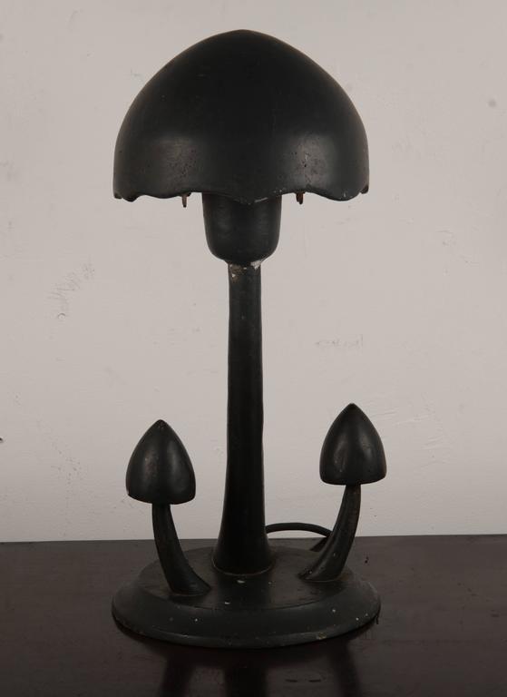 Black painted cast aluminum mushroom lamp. These were originally designed to be outdoor lighting.