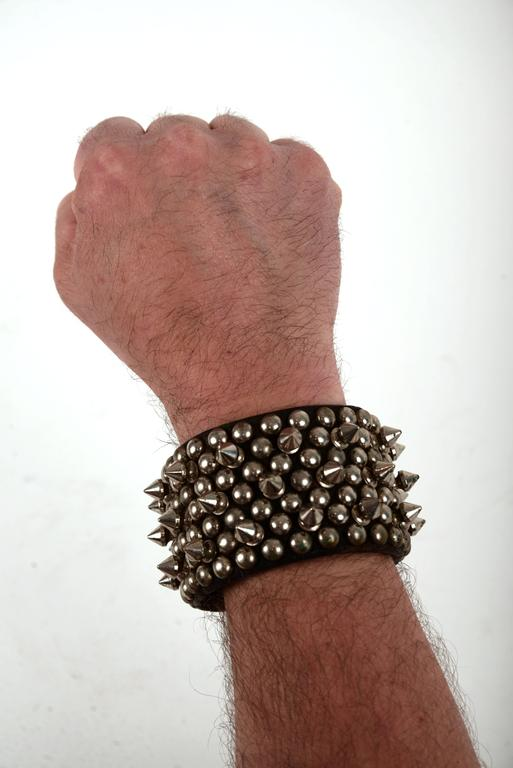 Collection of four handcrafted leather spike/studded accessories for the neck and wrist.