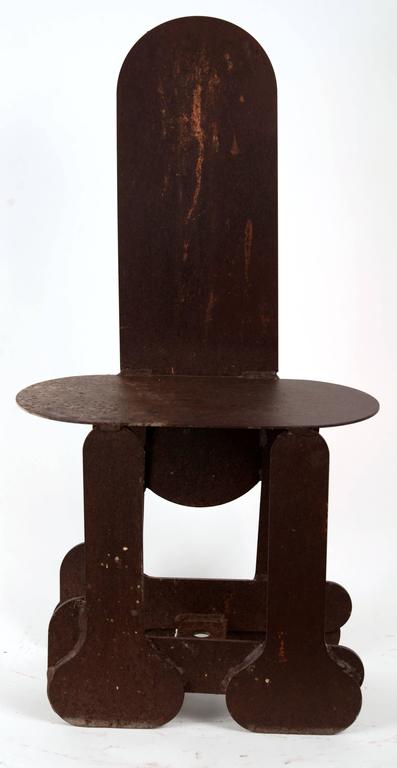 Steel plate Folk Art chair constructed out of penis shaped elements. This is signed Alex.