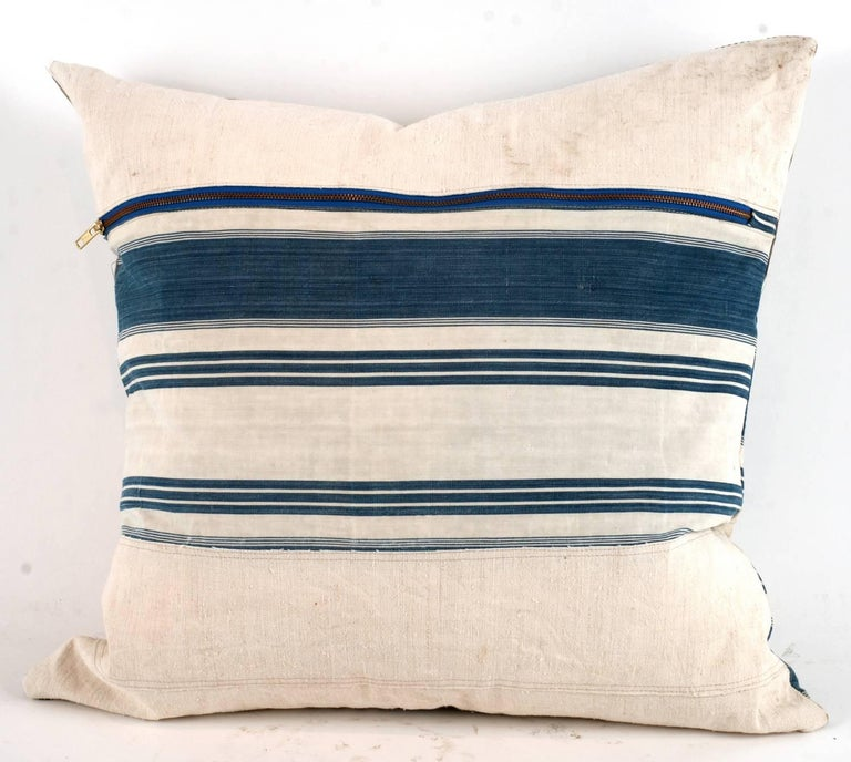 One of a king large-scale pillow constructed out of vintage textiles including canvas, drop cloth and sailcloth. All materials have been thoroughly laundered and are machine washable down inserts give these a wonderful plush relaxed feel and