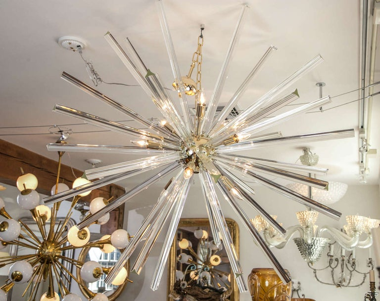 Starburst Sputnik ceiling fixture comprised of blown triedri crystal glass rods in two lengths, hardware available in brass, chrome and champagne matte brass color. Measuring 44
