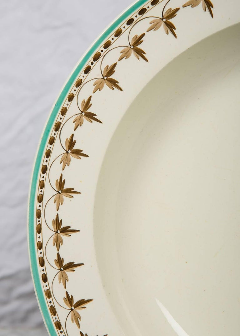A set of eleven Wedgwood 18th century creamware soup dishes the borders decorated with a beautiful brown necklace design, highlighted by a lively turquoise painted edge. The dishes measure 9.75 inches diameter. The condition is excellent The price