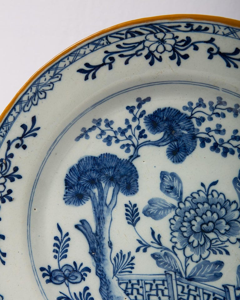 Dutch Pair of Antique Delft Blue and White Chargers Showing a Garden Scene circa 1780