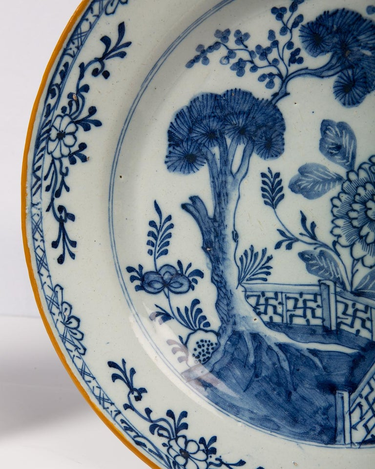 18th Century Pair of Antique Delft Blue and White Chargers Showing a Garden Scene circa 1780