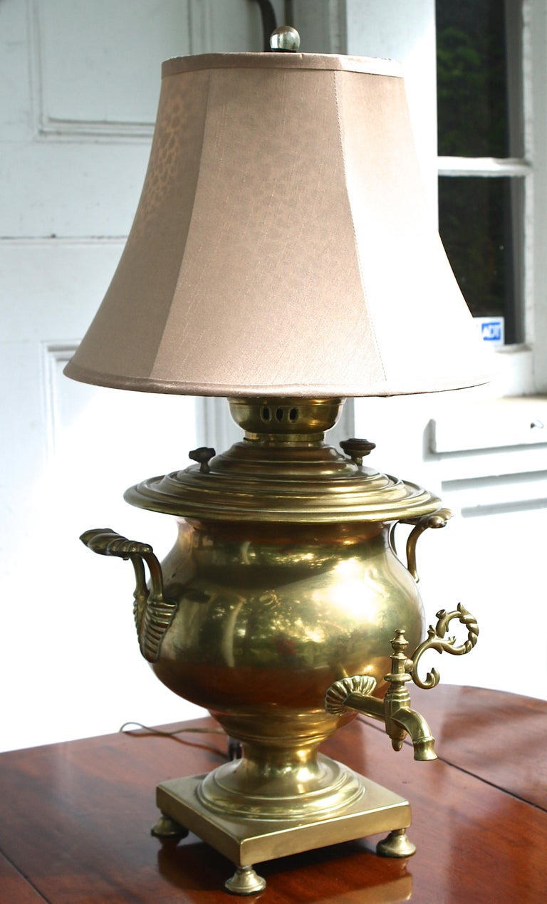 Dating from the reign of Alexander III (1881-1894), a Russian brass samovar mounted as a table lamp in the mid-late 20th century. Structurally intact with minimally invasive mounting. The samovar measures 17 inches tall by 16 inches diameter. The