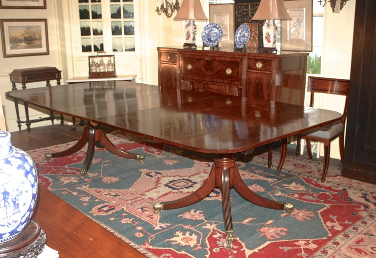 A rectangular honey-colored mahogany two pedestal dining table, comfortably seating ten with its 21 1/2