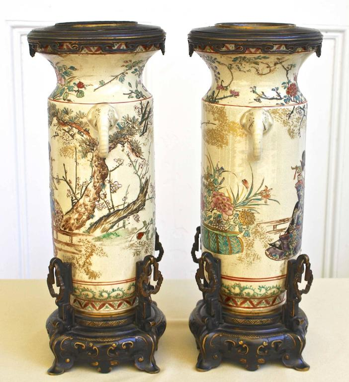 Meiji Period (1868-1912) from one of the finest Japanese makers for export to the European market; a pair of bronze-mounted intricately hand-painted earthenware vases.  As shown in Image #9, each contains an interior metal European marker: