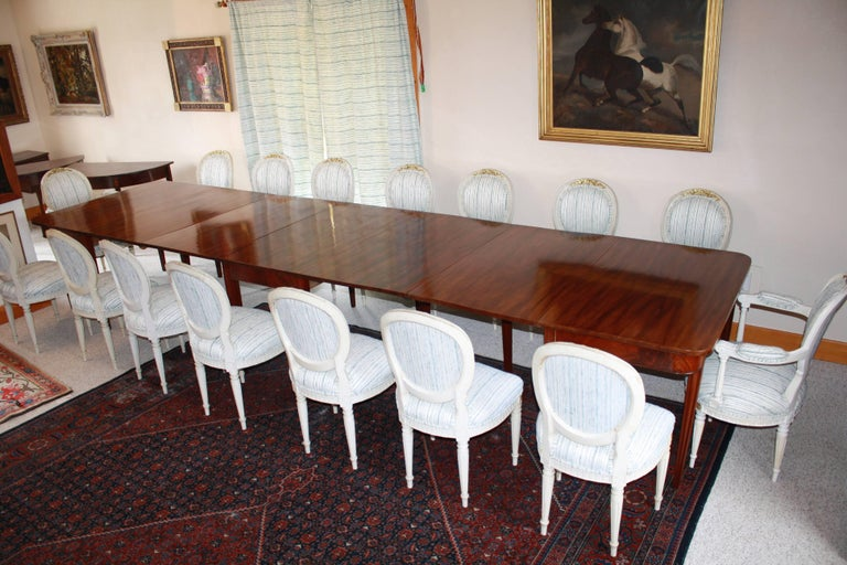 An American tripartite banquet table in the Hepplewhite manner, bench-made in 1880 for the German Embassy in Washington D.C.  Handcrafted Honduran mahogany on tapering corner-fluted legs.  184 inches long, 48 inches wide, with 30 1/4 inch table-top