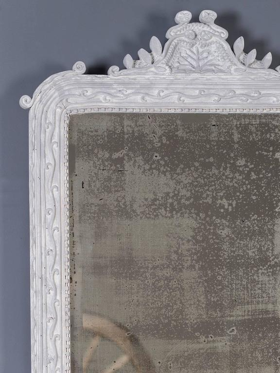 "Receive our new selections direct from 1stdibs by email each week. Please click ""Follow Dealer"" button below and see them first!  The rustic appearance of this hand-carved and painted Louis Philippe French mirror circa 1890 is most unusual. Please"