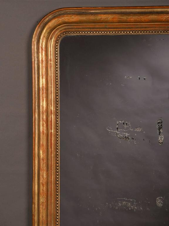 Receive our new selections direct from 1stdibs by email each week. Please click follow dealer below and see them first!  The color of this antique French mirror is sensational. Because most of the gold leaf has disappeared the rich red undercoat