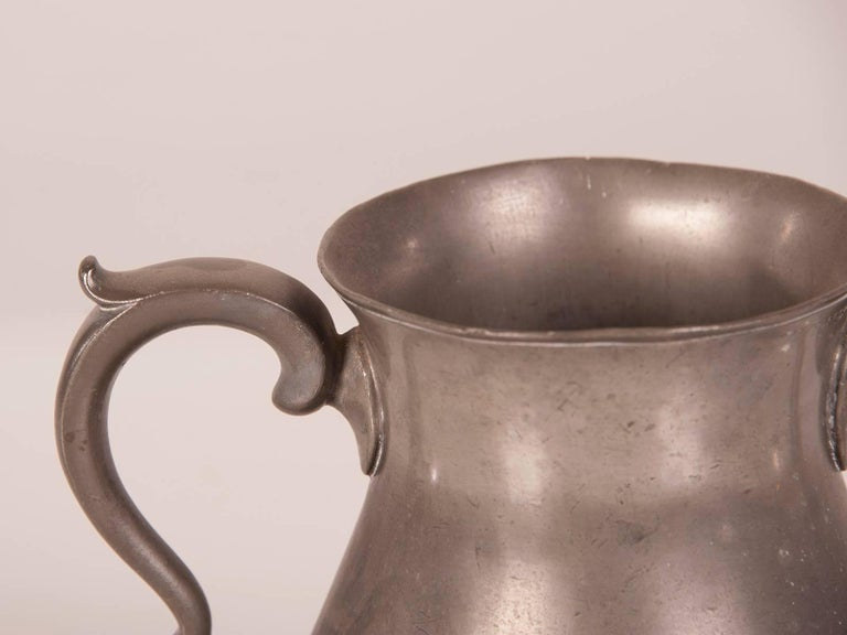 A large antique French Louis Philippe pewter urn with two shaped handles on the opposite sides of the vessel, circa 1850. Designed to seen from all directions the scale of this pewter vessel is quite impressive. The grand decorative handles possess