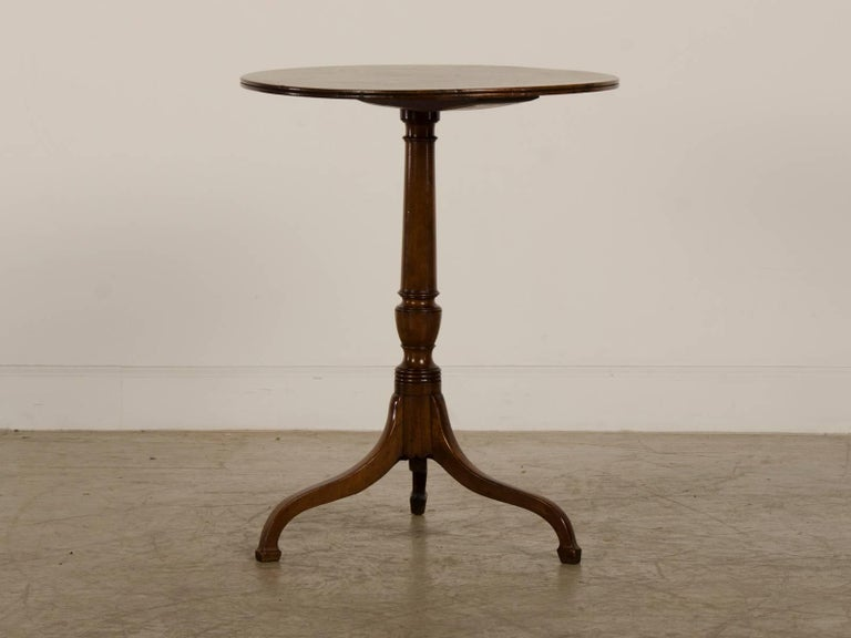 Be the first to see our new selections direct from 1stdibs! Please click on follow below.  A splendid antique English Regency period Sheraton style mahogany side table with a single board top from England, circa 1820. This supremely elegant table