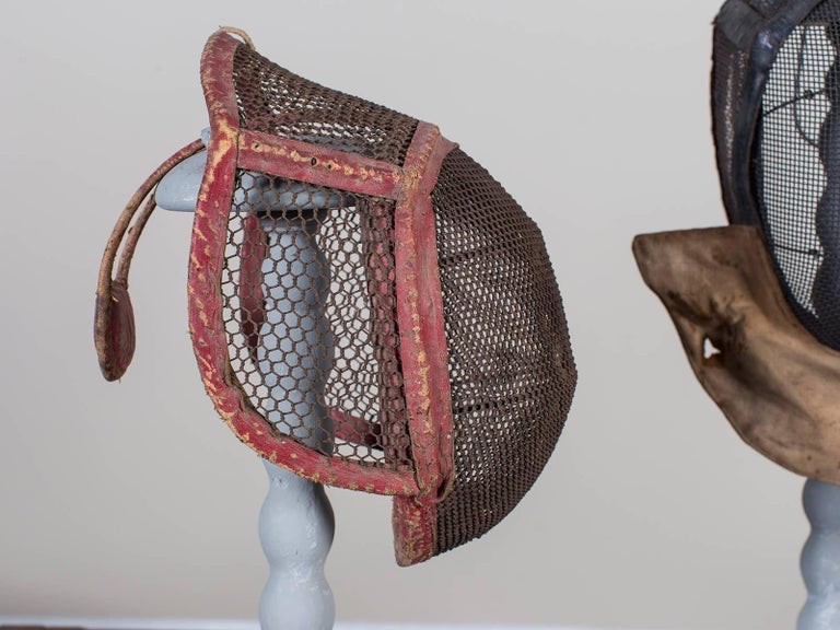 Early 20th Century Set of Three Antique French Fencing Masks, circa 1910 Each on a Stand For Sale