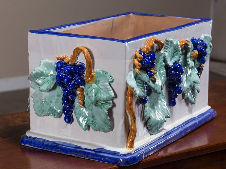 Be the first to see our new arrivals directly through 1stdibs! Please click follow dealer below.   This handmade rectangular ceramic is vintage Italian circa 1980 and features not only exuberant colors but hand applied grapes, vines and leaves