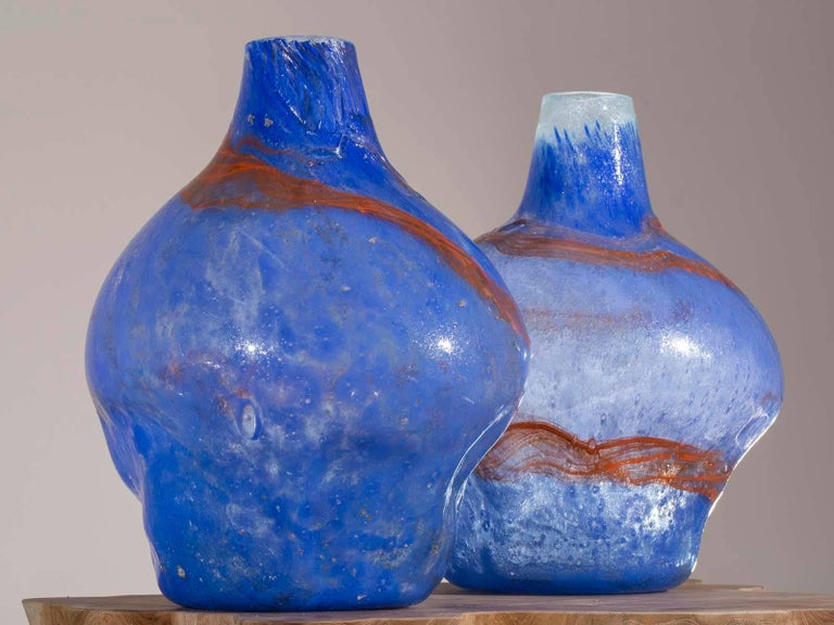 A pair of modern handblown glass vases with blue and orange decoration from Holland. Because each vase is handblown they have a different shape while being the same height. Please take a moment to enlarge the photographs to see the appealing shape