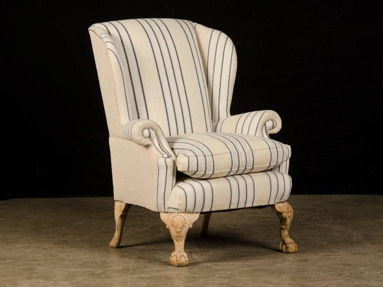 Receive our new selections direct from 1stdibs by email each week. Please click Follow Dealer below and see them first!  A Chippendale style antique English wing chair circa 1880. This terrific armchair has been updated for the 21st century by