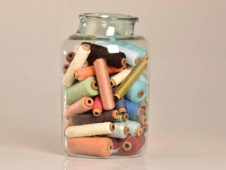 Hand Blown Antique Glass Bottle filled with Bobbins circa 1920 2