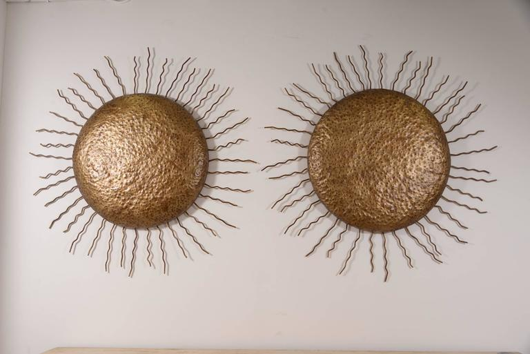 Very chic and large pair of decorative Italian tole suns. Can be sold individually.