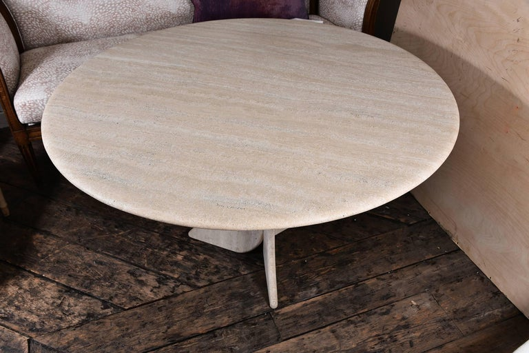 Vintage French travertine table with unusual base. In fabulous condition.