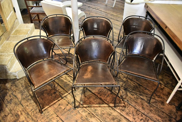 A set of 6 iron and leather Spanish chairs with authentic patina. Signs of age on some of the leather.