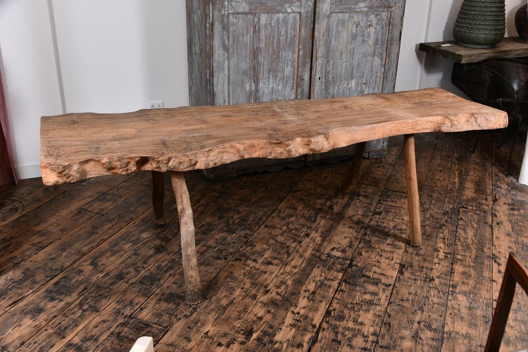 19th century French Primitive table with live edge, could be used as a desk or console.