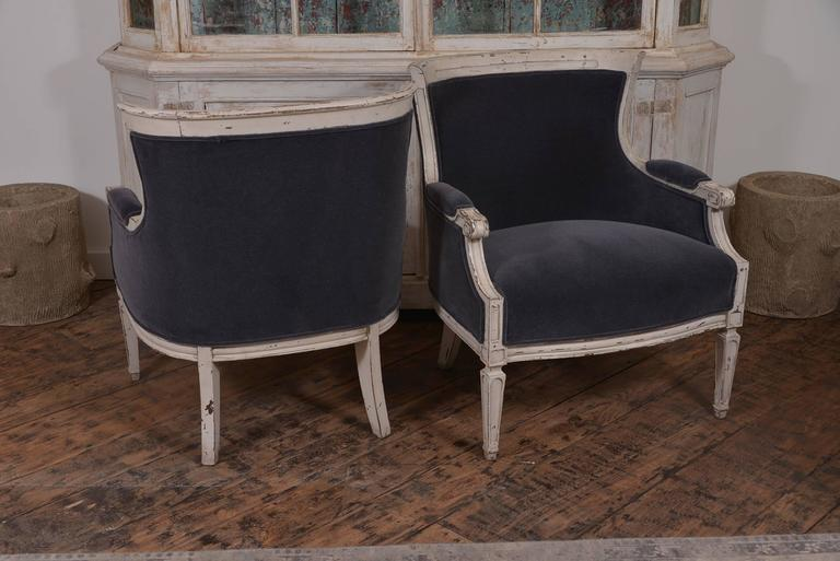 Handsome pair of 19th century painted French club chairs newly upholstered in Maharam mohair. Extremely comfortable.