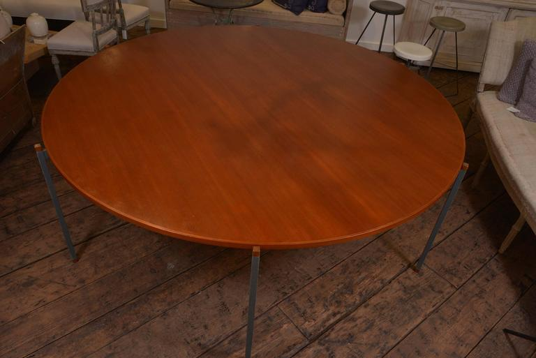 Very chic and large scale Danish dining table, simple painted iron base with mahogany wood top that has been waxed. 1950s.