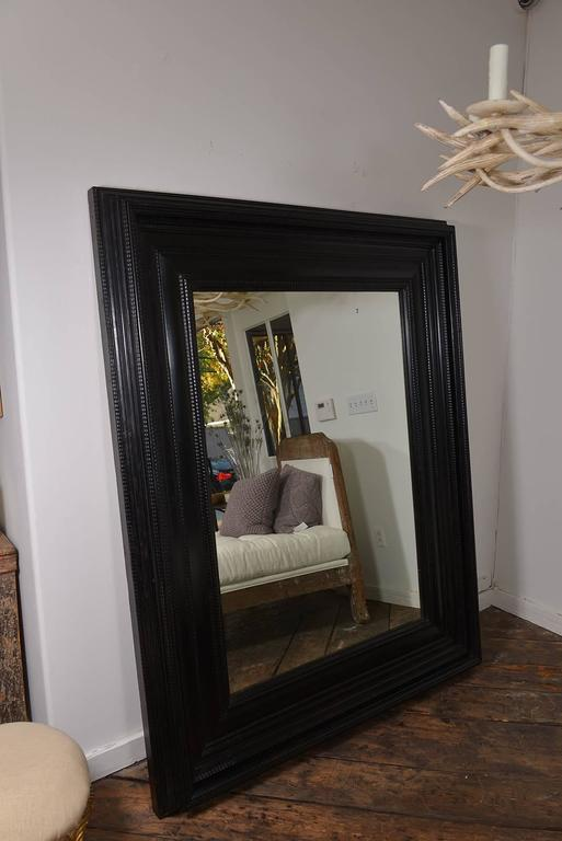 A grand scale Dutch ebonized mirror. With beautiful detailing, circa 1800, from Italy.