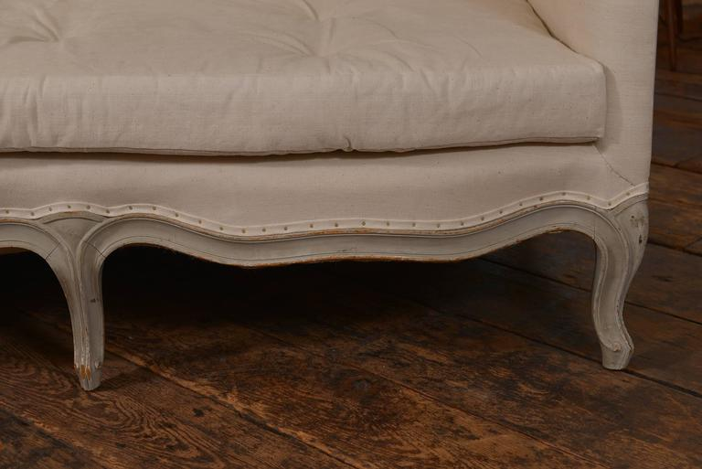 Late 19th century French Louis XVI style sofa with original paint finish.
