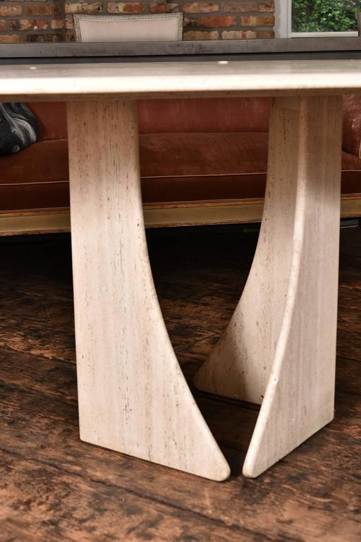 Very sophisticated French oval travertine table, from the 1960s.