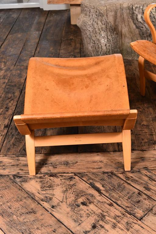 A rare pair of Mathsson Pernilla chairs including ottomans. Comes with leather seats and head rest and bentwood frames in beech. The set remains in overall good vintage condition, with presence of wear to original leather consistent with age and