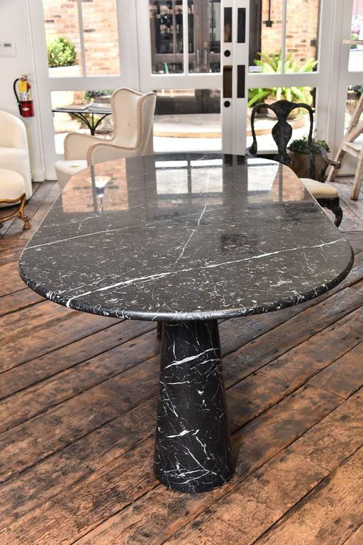 A vintage marble Angelo Mangiarotti double pedestal black marble table. It is very rare to find a double pedestal in this size and condition. Made sometime between the 1960s-1970s.