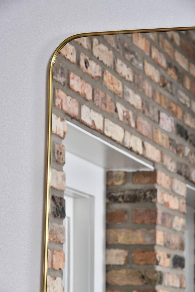 1950s thin frame brass Italian mirror.