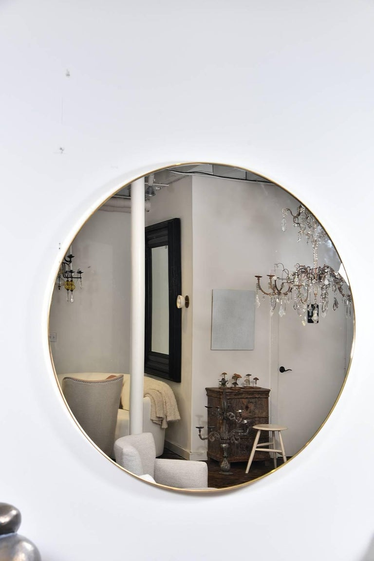 Super chic round, large thin frame brass mirror from the 1960s. A fabulous piece!