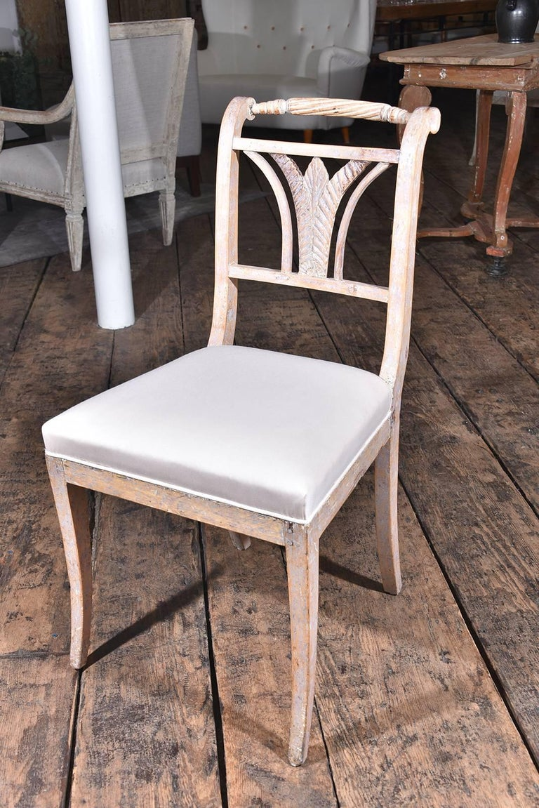 Six Gustavian dining chairs. Dry scraped to the original paint, circa 1810. Upholstered in Holland and sherry wool.