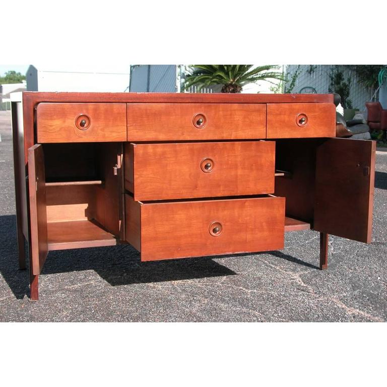 Classically elegant, this Mid-Century Modern Drexel counterpoint piece can be used as a credenza or dresser; with six deep drawers of ample storage and behind double doors more storage. Drawer pulls are recessed with small patina