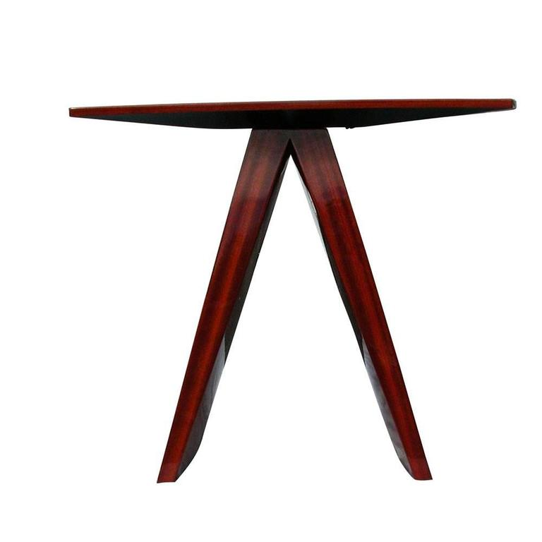 Wonder series console side table.   Gently sloping, canted legs. Diamond pattern table tops with graceful bowed ends.   Pau Ferroveneer in high gloss polished finish.