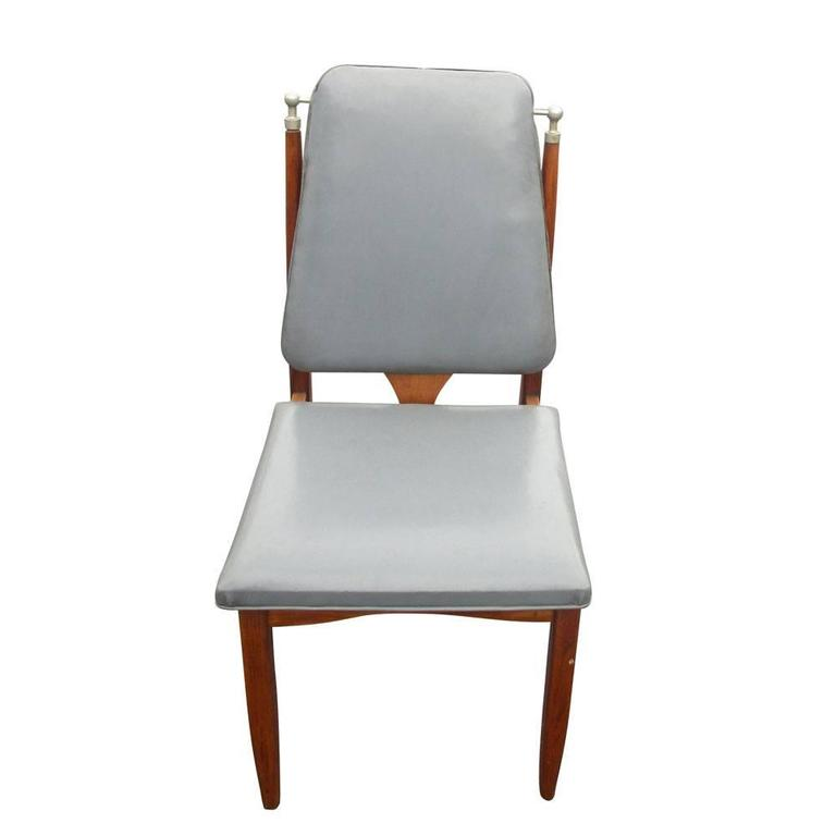 Vintage Mid-Century set of six (6) dining chair. Grey vinyl upholstered seat and back. Wood frame with chrome corners, circa 1960s.  Measures: 17.5