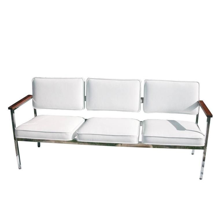 Vintage Mid-Century. Three-seat steel case sofa.   Chrome with new white leather Oak finish armrests  Restored