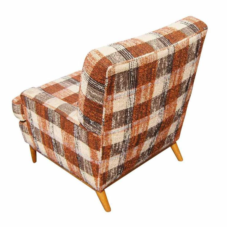 Vintage T.H. Robsjohn-Gibbings for Widdicomb lounge armchair. Wood splayed legs. Plaid fabric upholstery   Price includes reupholstering in COM.  Additional handling time will be required if reupholstered.