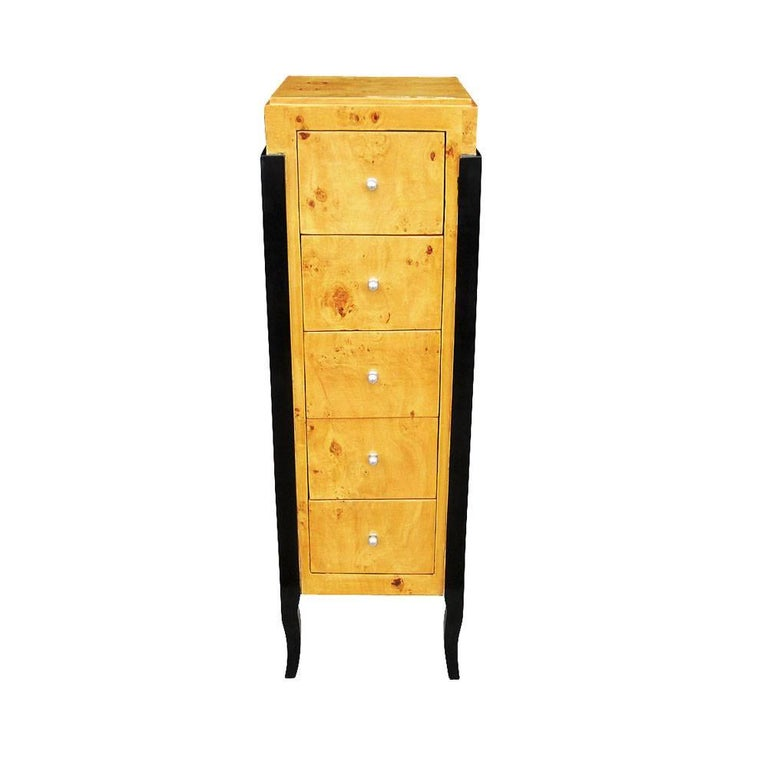 Stunning contemporary burled wood Art Deco chest. Five drawers and metal pulls.  Ebonized legs.  Measures: Width 16