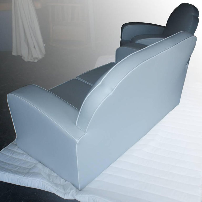 Professionally newly upholstered in off-white vinyl with an accentuated white piping 